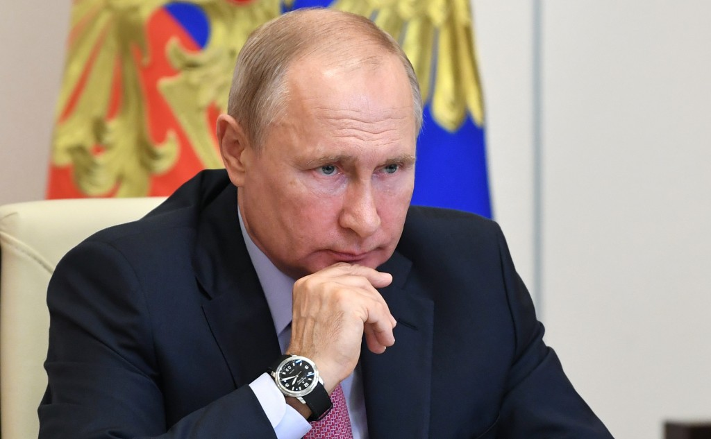 FILE - In this Tuesday, June 9, 2020 file photo, Russian President Vladimir Putin attends a meeting with Sberbank chairman German Gref via video confe...