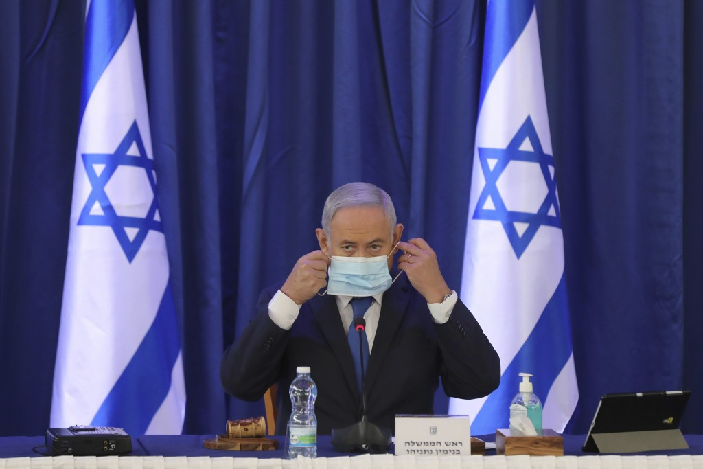Israeli Prime Minister Benjamin Netanyahu wearing a face mask attends a government Cabinet meeting at the Ministry of Foreign Affairs in Jerusalem, Is...