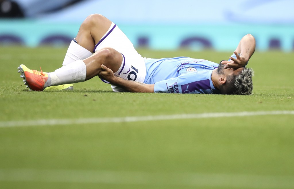 Manchester City's Sergio Aguero reacts as he lies on the pitch injured during the English Premier League soccer match between Manchester City and Burn...