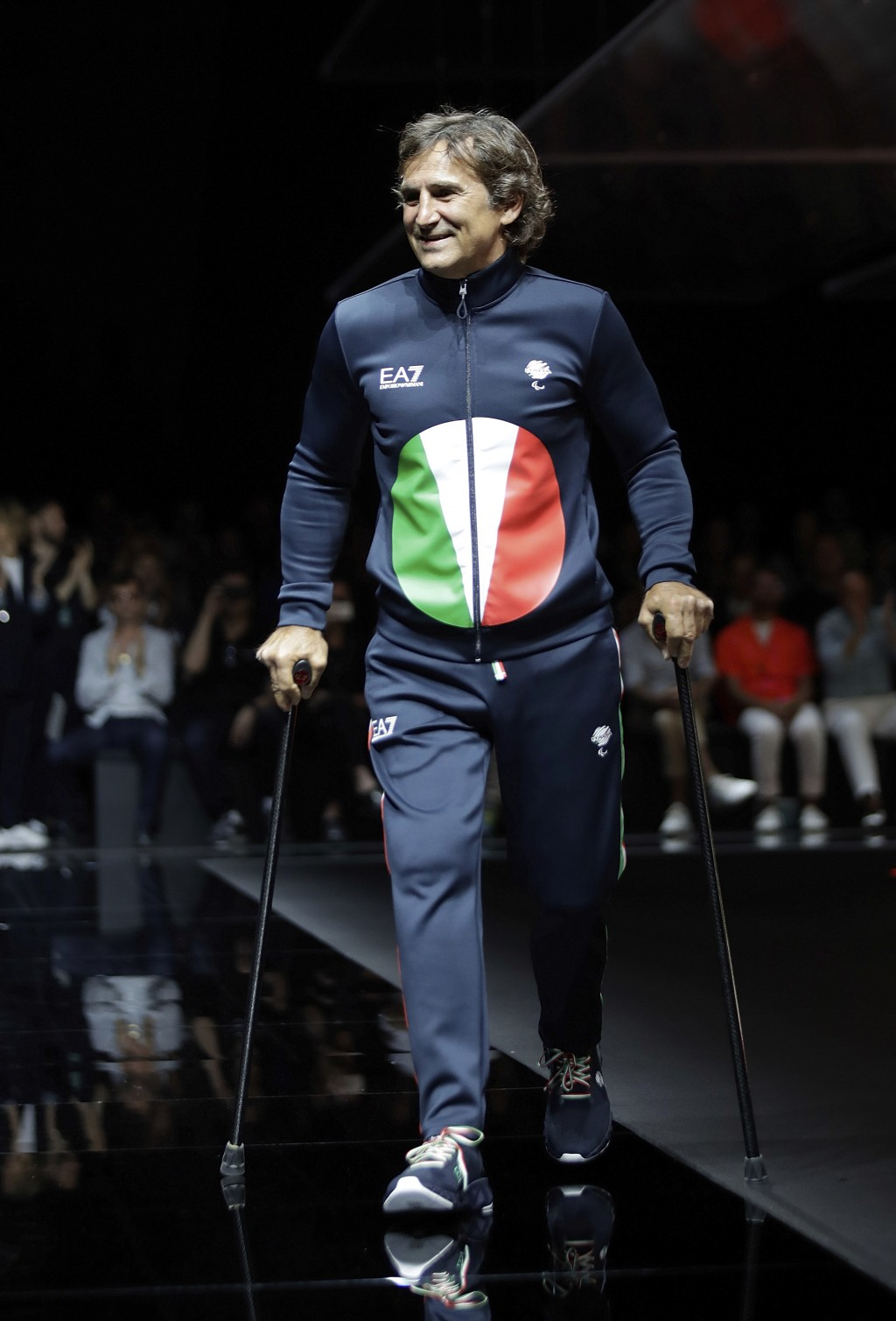 In this photo taken on Saturday, June 15, 2019 file photo, Alex Zanardi takes the catwalk during the Emporio Armani men's Spring-Summer 2020 collectio...