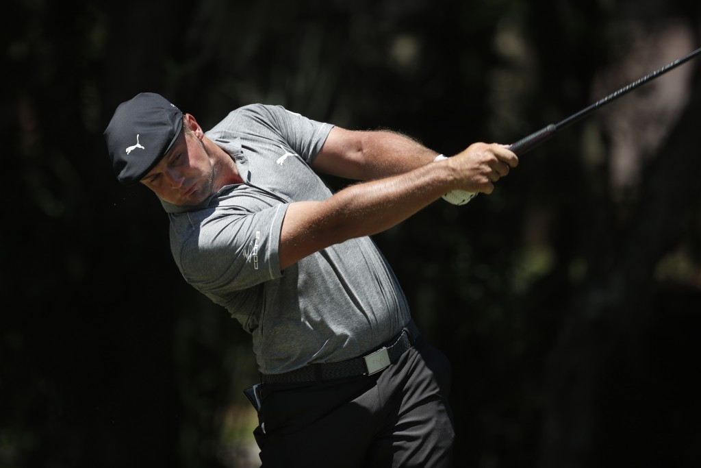 Bryson DeChambeau hits off the second tee during the third round of the RBC Heritage golf tournament, Saturday, June 20, 2020, in Hilton Head Island, ...
