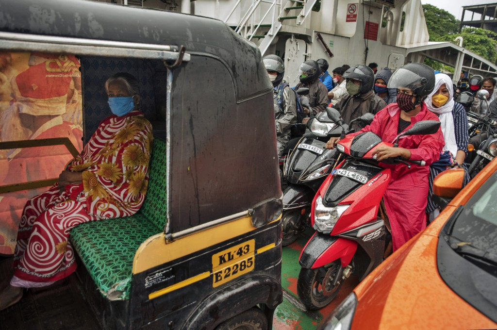 Commuters wearing masks as a precaution against the coronavirus travel in a ferry in Kochi, Kerala state, India, Monday, June 22 2020. India is the fo...