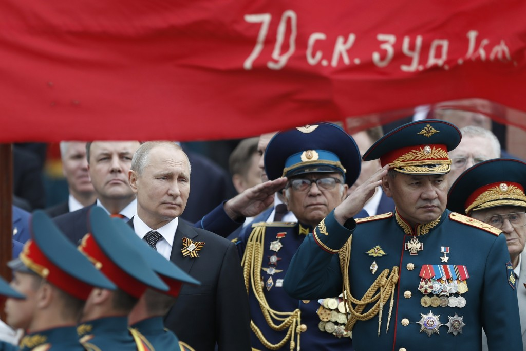 FILE - In this file photo taken on Thursday, May 9, 2019, Russian President Vladimir Putin, left, and Russian Defense Minister Sergei Shoigu, right, a...
