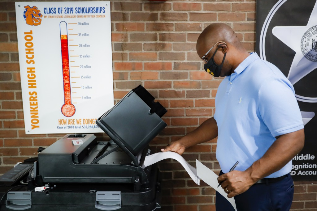 Jamaal Bowman votes at a polling station inside Yonkers Middle/High School, Tuesday, June 23, 2020, in Yonkers, N.Y. Bowman is running against veteran...
