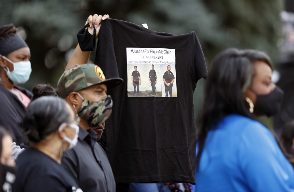A supporter holds up a shirt to call attention to the death of Elijah McClain in August 2019 in Aurora, Colo., during a news conference on the west st...
