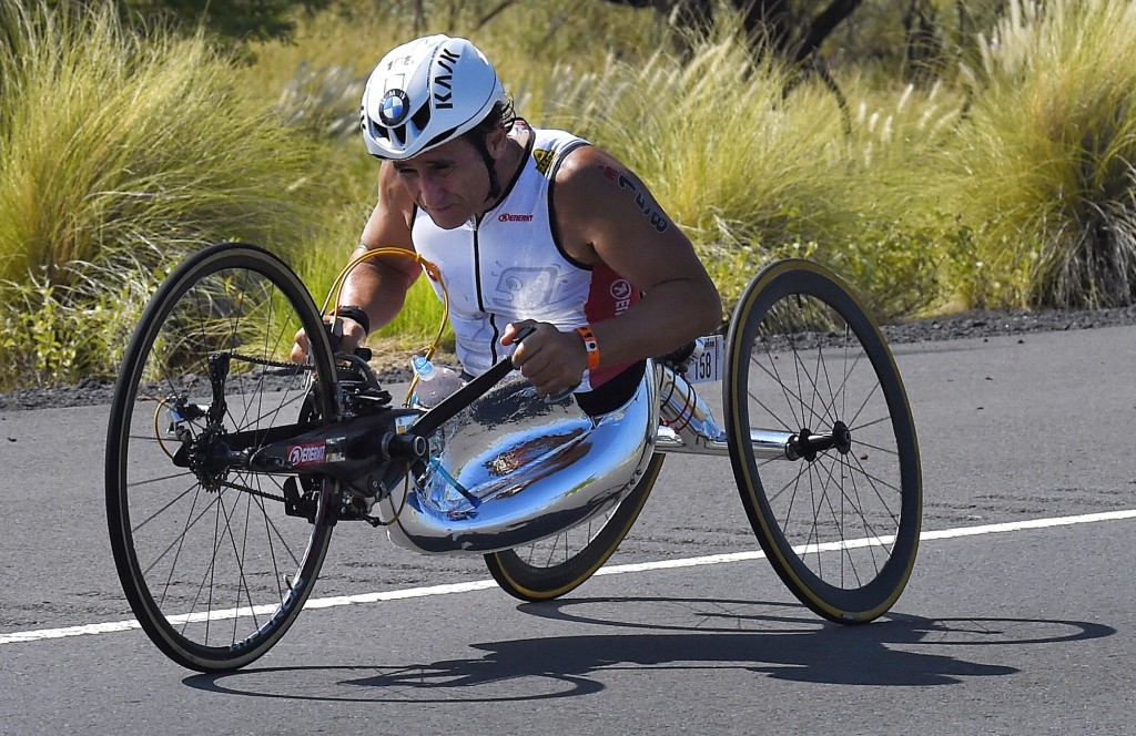 FILE - In this Saturday, Oct. 10, 2015 file photo, Alex Zanardi, of Italy, rides during the cycling portion of the Ironman World Championship Triathlo...