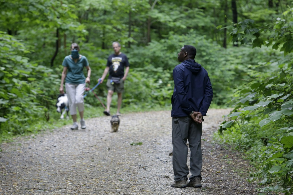 Keith Russell, right, program manager of urban conservation at Audubon Pennsylvania, listens for bird songs while conducting a breeding bird census, a...