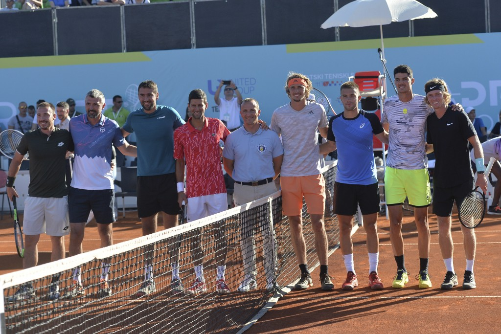In this photo taken June 19, 2020, Serbian tennis player Novak Djokovic, fourth left, poses with other players at a tournament in Zadar, Croatia. Nova...