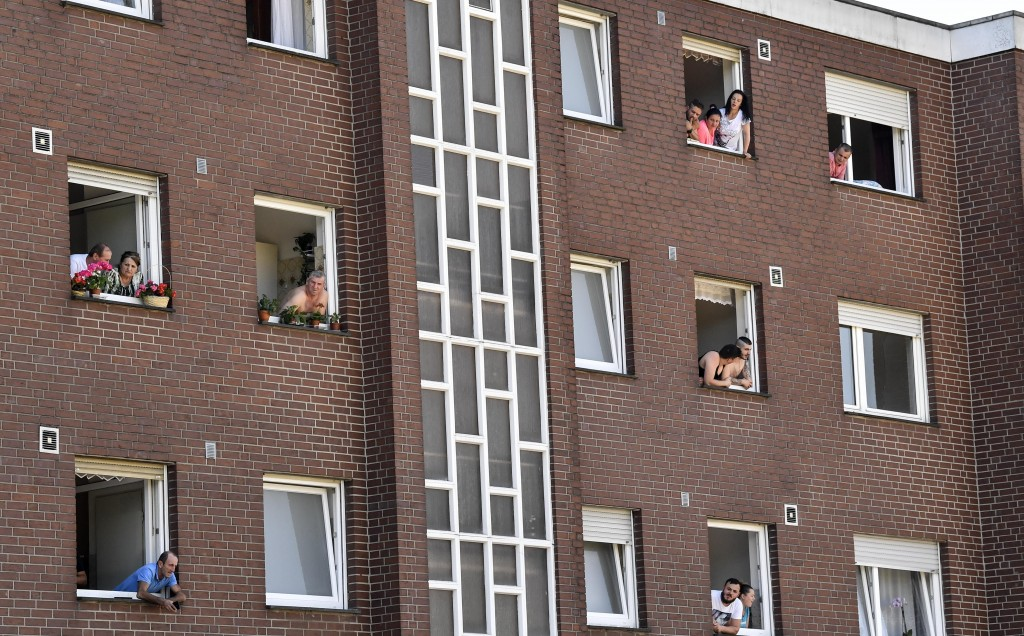 File---File picture taken June 23, 2020 shows Toennies employees and their families being quarantined in their apartments behind fences in Verl, Germa...