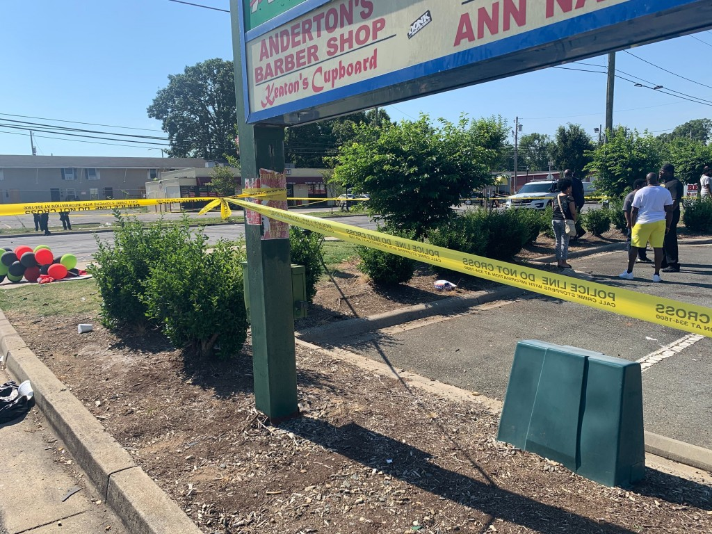 Police tape is seen near the scene of a shooting early Monday, June 22, 2020 in Charlotte, North Carolina, that resulted in two deaths and several mor...