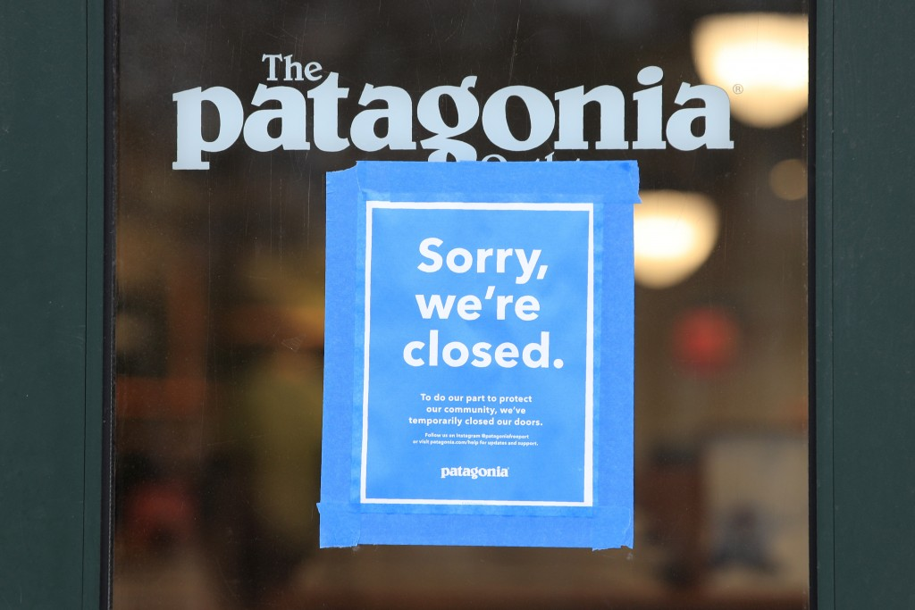 FILE - This April 9, 2020 file photo shows a closed Patagonia clothing store in Freeport, Maine. The outdoor gear company Patagonia is the latest bran...