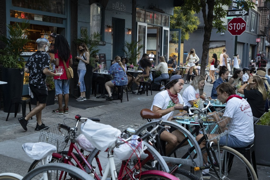Customers dine outside Dudley's, Monday, June 22, 2020, in New York. New York City Mayor Bill de Blasio says he is delaying the planned resumption of ...