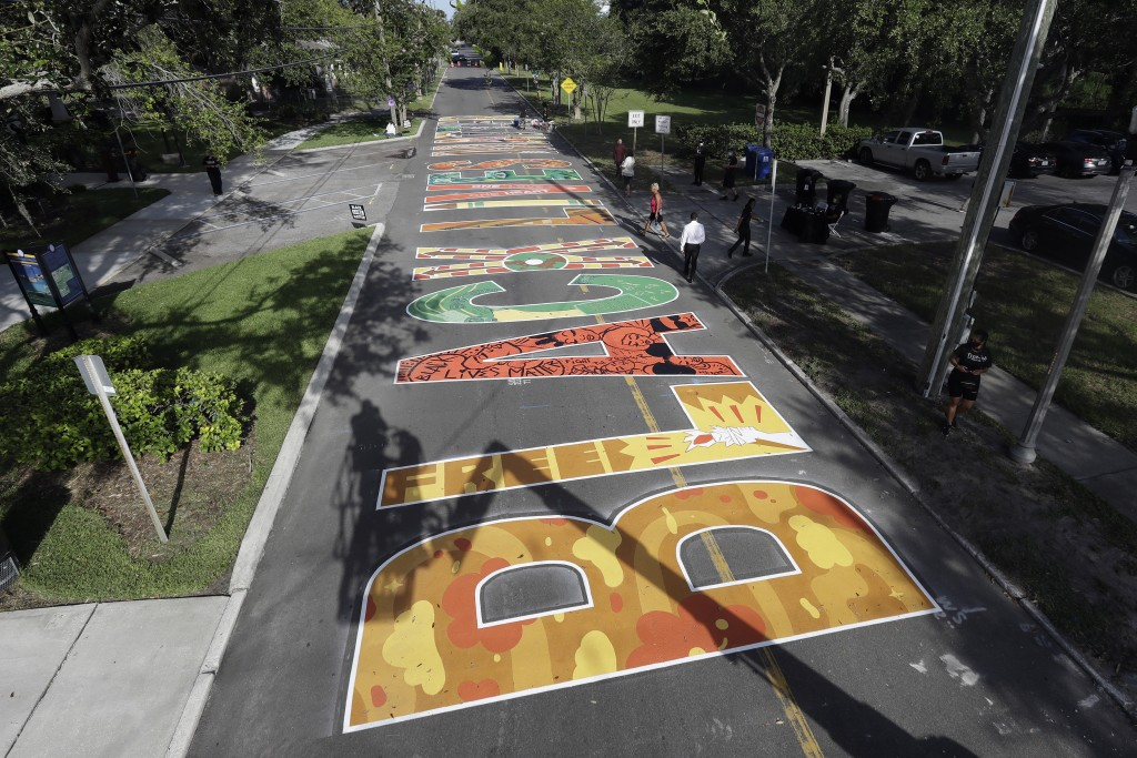 Several local artists painted Black Live Matter mural on the street during a Juneteenth 2020 celebration outside the Dr. Carter G. Woodson African Ame...