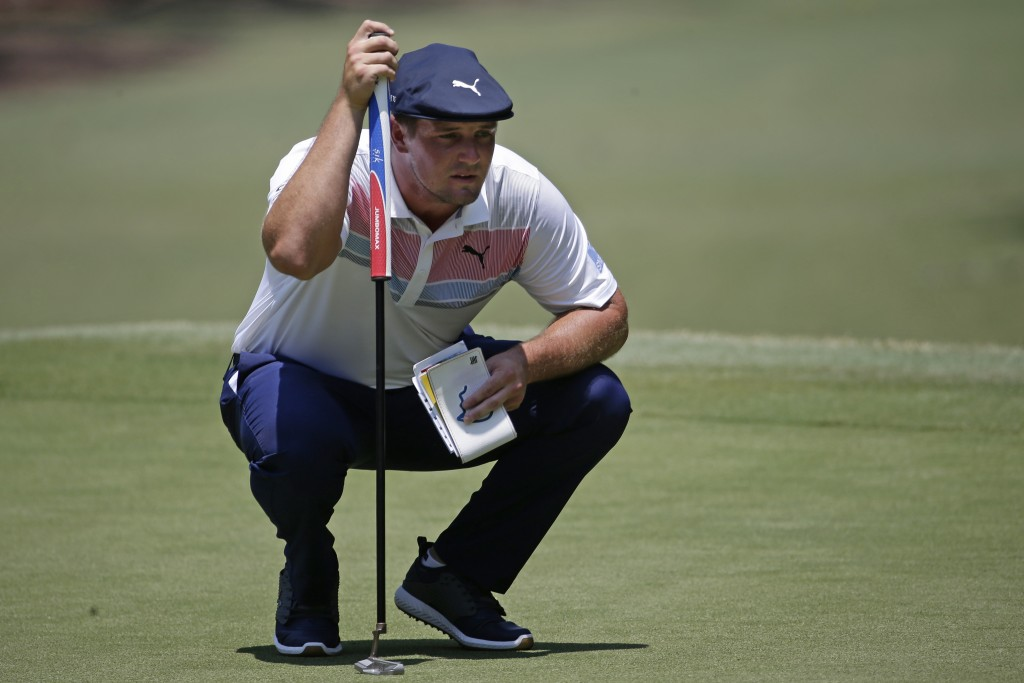Bryson DeChambeau lines up a shot on the first green during the final round of the RBC Heritage golf tournament, Sunday, June 21, 2020, in Hilton Head...