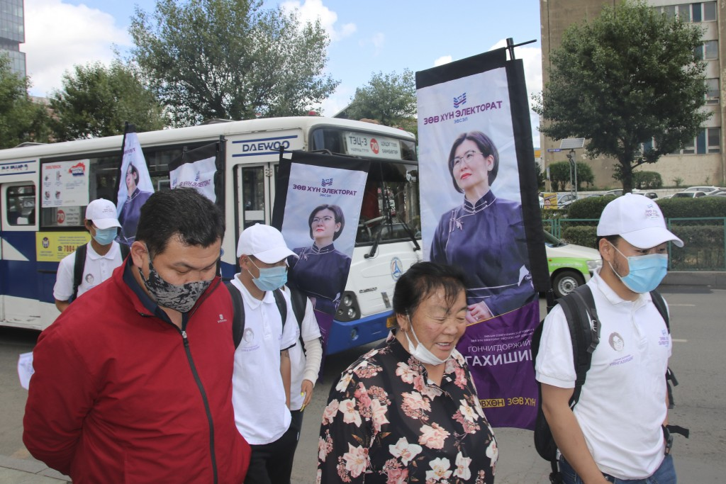"Campaign workers and supporters of ""Right person-Electorate"" coalition led by National Labor Party parade with posters of their candidates and coaliti..."