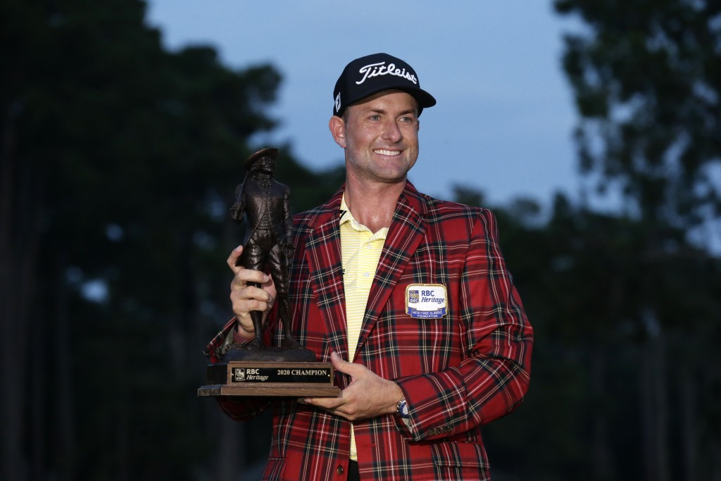 Webb Simpson holds the championship trophy after winning the RBC Heritage golf tournament, Sunday, June 21, 2020, in Hilton Head Island, S.C. (AP Phot...