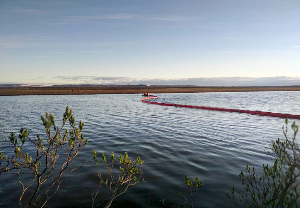FILE - In this handout file photo dated Tuesday, June 2, 2020, provided by the Russian Marine Rescue Service, rescuers work to prevent the spread from...