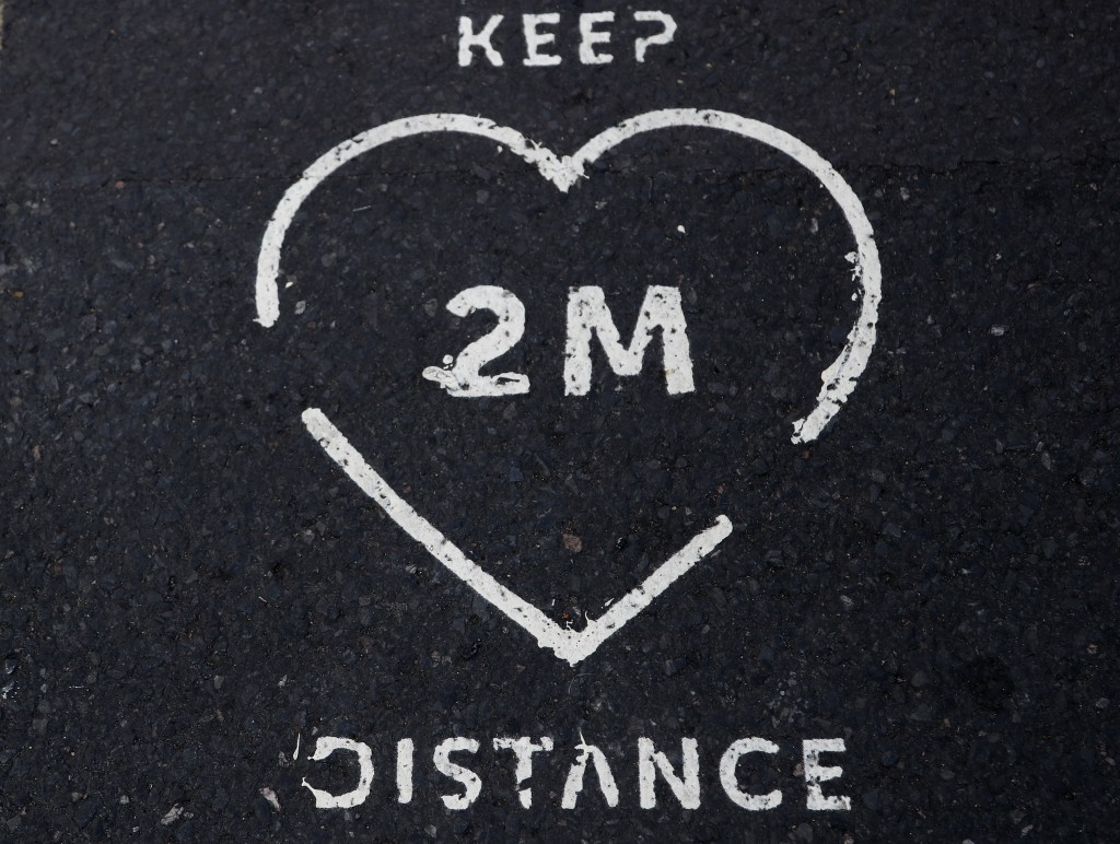 A two meter distance print on the pavement in London, Monday, June 22, 2020.  The two-metre social distancing rule will be under review as the UK rela...