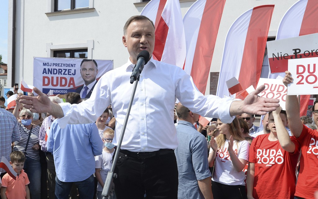 FILE - In this Wednesday, June 17, 2020 file photo, Polish President Andrzej Duda waves to supporters as he campaigns for a second term in Serock, Pol...