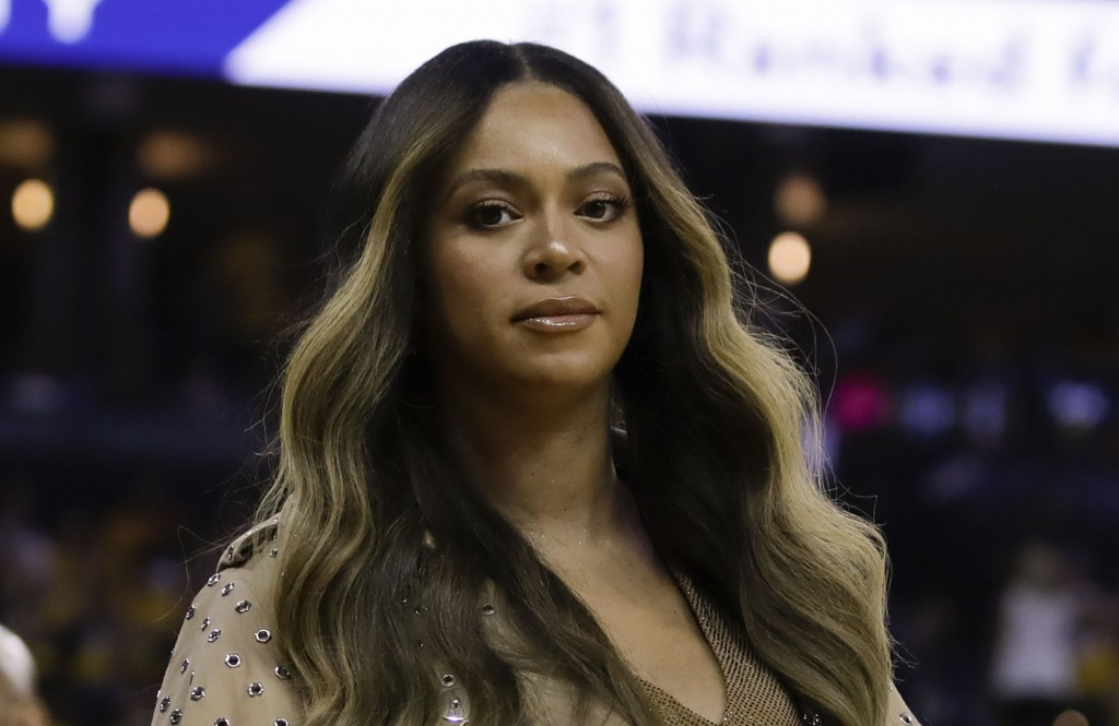 FILE - In this Wednesday, June 5, 2019, file photo, Beyonce walks to her seat during the first half of Game 3 of basketball's NBA Finals between the G...