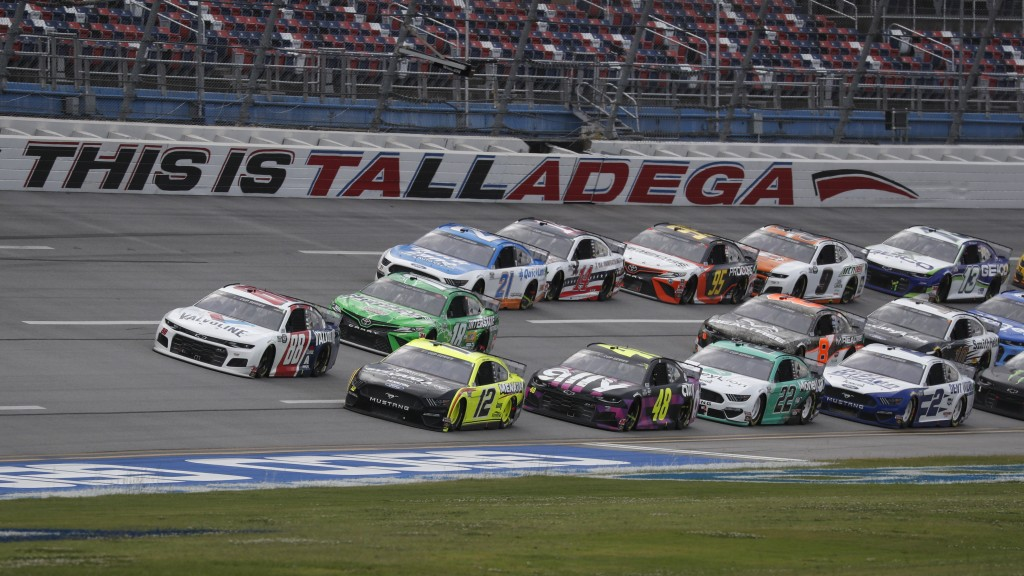 Ryan Blaney (12) takes the inside line during a restart of a NASCAR Cup Series auto race at Talladega Superspeedway in Talladega Ala., Monday, June 22...