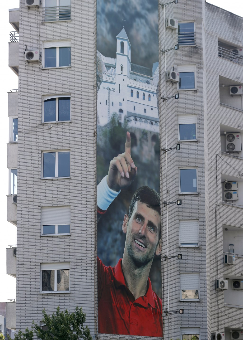 A billboard depicting Serbian tennis player Novak Djokovic and the Christian Orthodox monastery of Ostrog is seen on a building in Belgrade, Serbia, W...