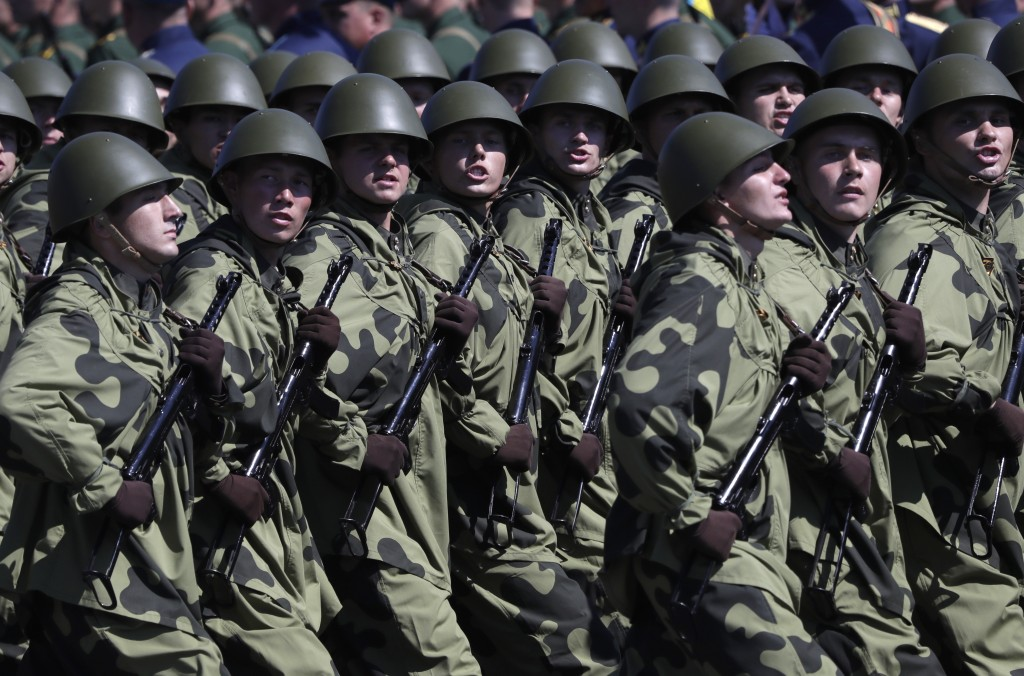 Russian soldiers dressed in Red Army World War II uniforms march toward Red Square during the Victory Day military parade marking the 75th anniversary...