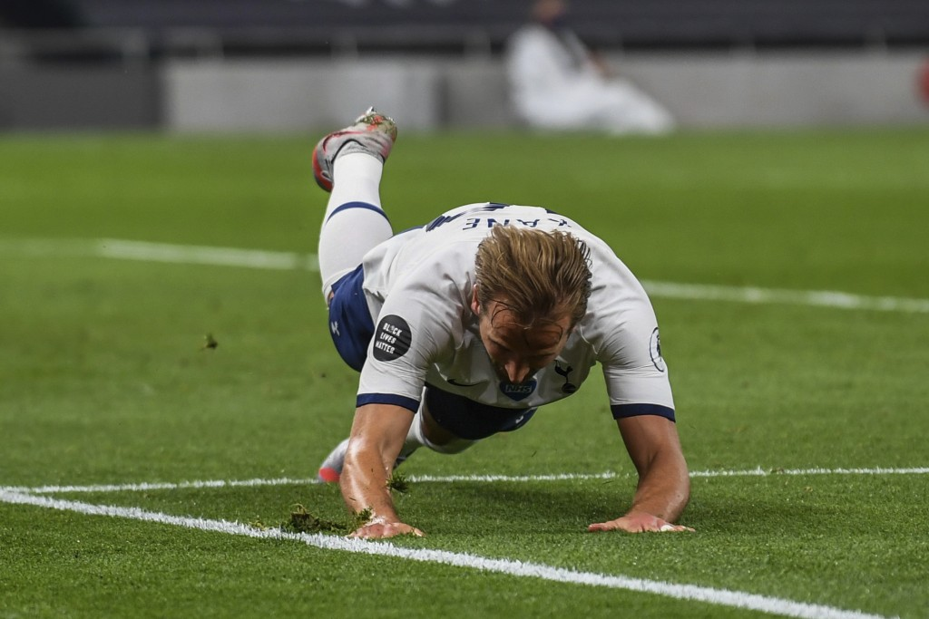 Tottenham's Harry Kane celebrates after scoring his team's second goal during the English Premier League soccer match between Tottenham Hotspur and We...