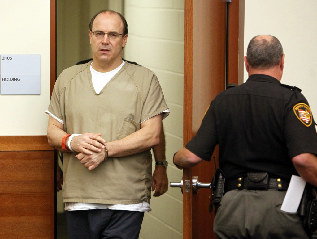 This Thursday, Sept. 15, 2011 file photo shows former Ohio State and NFL quarterback Art Schlichter, left, entering the Franklin County Common Pleas C...