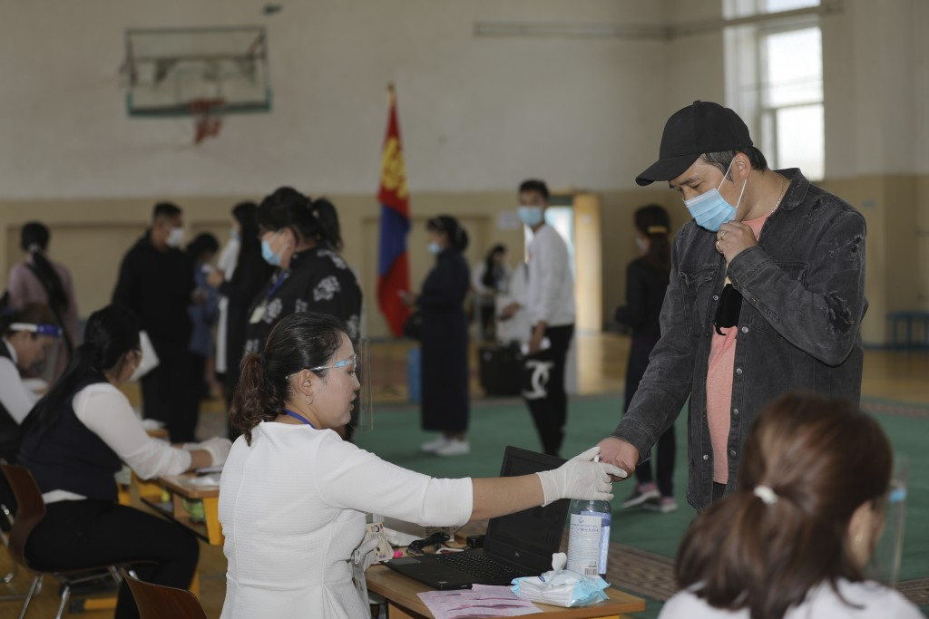 Residents arrive to vote at a polling station in Ulaanbaatar, Mongolia on Wednesday, June 24, 2020. Mongolians were voting in parliamentary elections ...