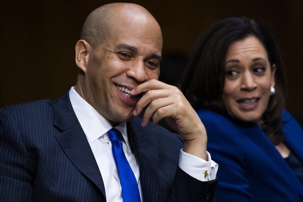 Sen. Cory Booker, D- N.J., speaks with Sen. Kamala Harris, D-Calif., during a Senate Judiciary Committee hearing on police use of force and community ...