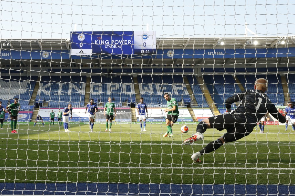 Leicester's goalkeeper Kasper Schmeichel, right, saves a penalty kicked by Brighton's Neal Maupay during the English Premier League soccer match betwe...