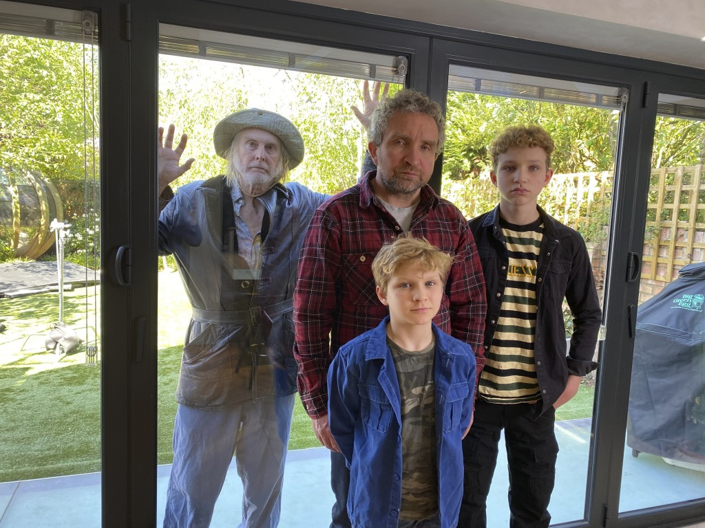 This image released by BritBox shows, from left, David Threlfall, Eddie Marsan and his sons Blu Marsan, foreground center, and Bodhi Marsan, who appea...