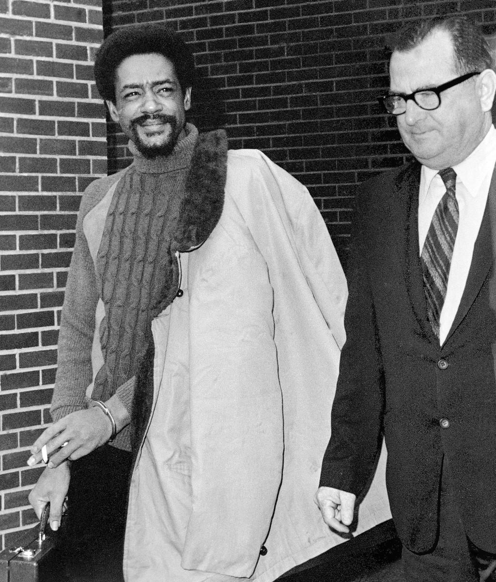 FILE - In this May 20, 1971 file photo Bobby Seale, left, national chairman of the Black Panther party, is escorted from the Montville state prison in...