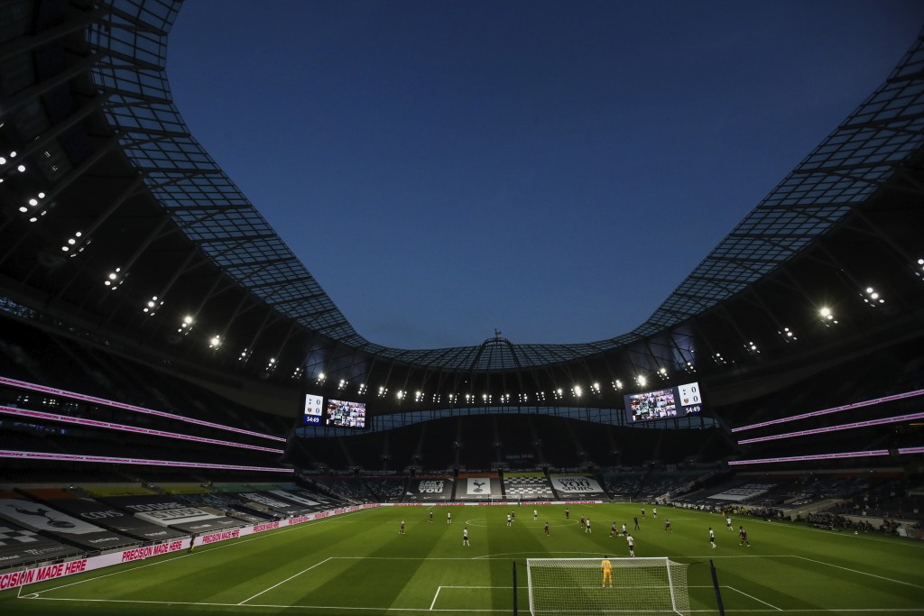 Tottenham Hotspur and West Ham play during the English Premier League soccer match at the Tottenham Hotspur stadium in London, England, Tuesday, June ...