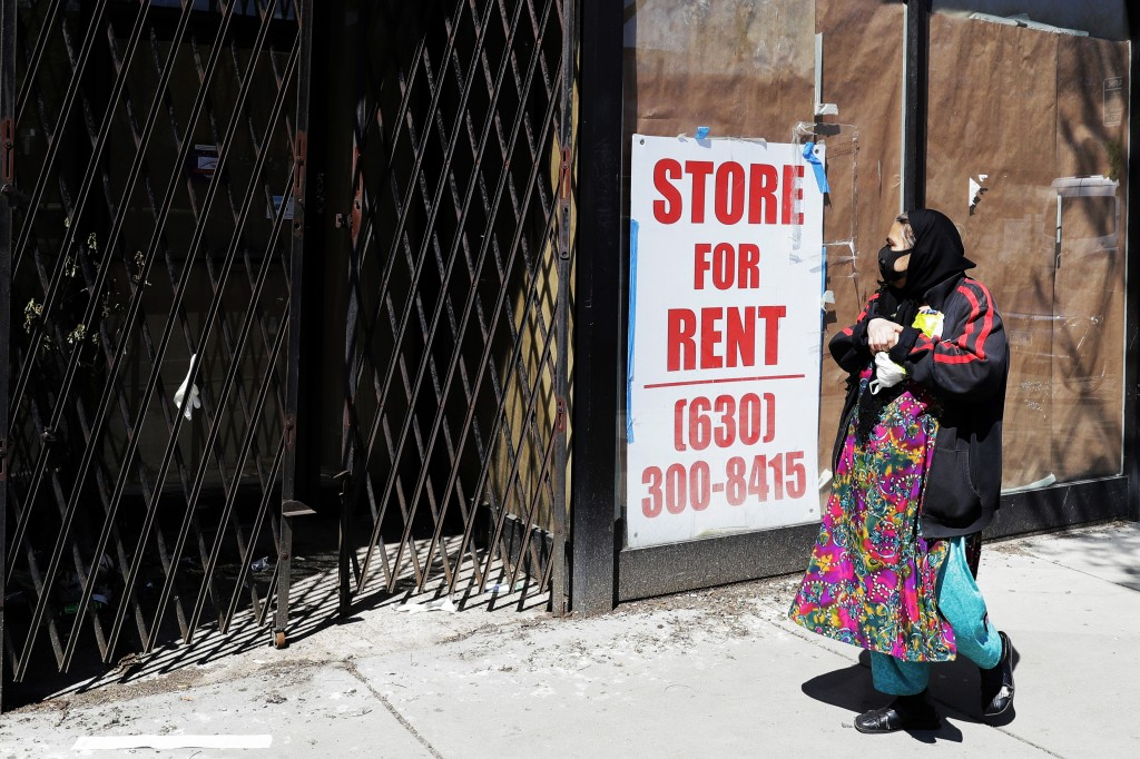 In this May 8, 2020 photo, Store for rent sign shows at the closed store in Chicago. Many businesses devastated by the coronavirus pandemic are expect...