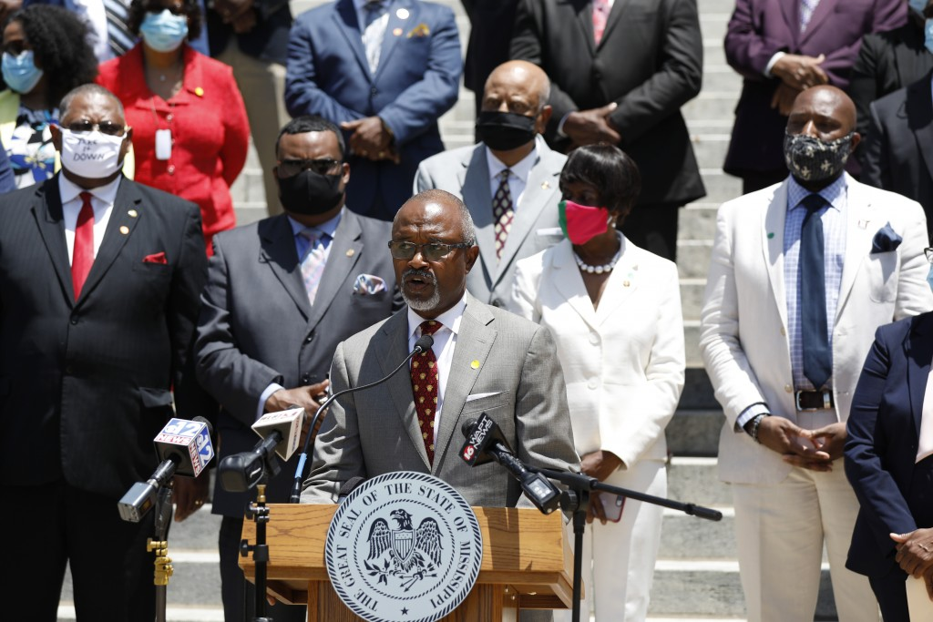 Rep. Robert Johnson, D-Natchez, Democratic leader of the House and flanked by party lawmakers and members of the Mississippi Legislative Black Caucus,...