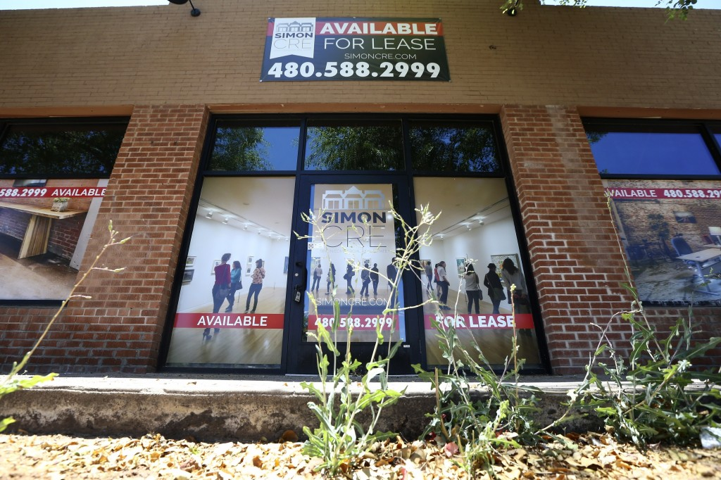 A business offers lease space available Sunday, June 21, 2020, in Phoenix.   Many businesses devastated by the coronavirus pandemic are expected to ab...