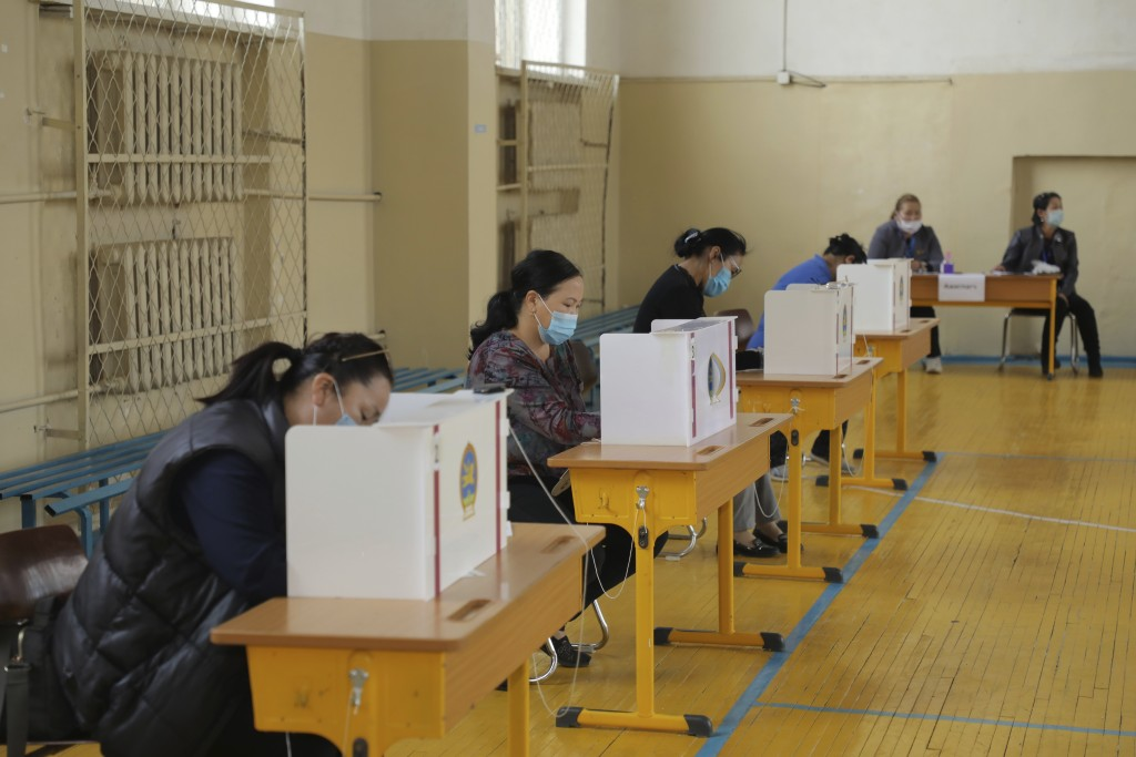 Residents vote at a polling station in Ulaanbaatar, Mongolia on Wednesday, June 24, 2020. Mongolians were voting in parliamentary elections Wednesday ...