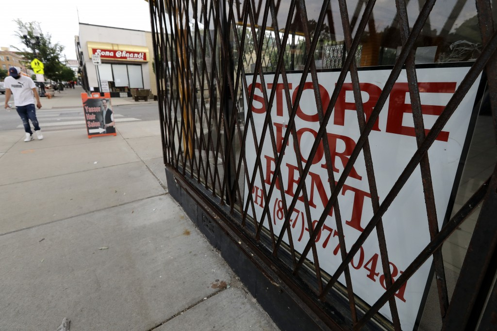 """A """"Store For Rent"""" sign is displayed at a commercial property in Chicago, Saturday, June 20, 2020. The coronavirus has had an impact on the commercial..."""
