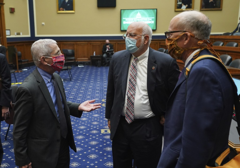 Director of the National Institute of Allergy and Infectious Diseases Dr. Anthony Fauci, left, speaks with Dr. Robert Redfield, director of the Center...