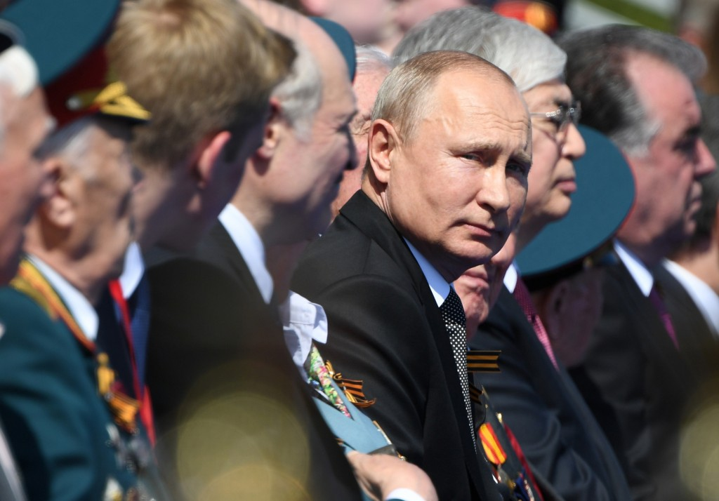Russian President Vladimir Putin looks on during the Victory Day military parade marking the 75th anniversary of the Nazi defeat on Red Square in Mosc...