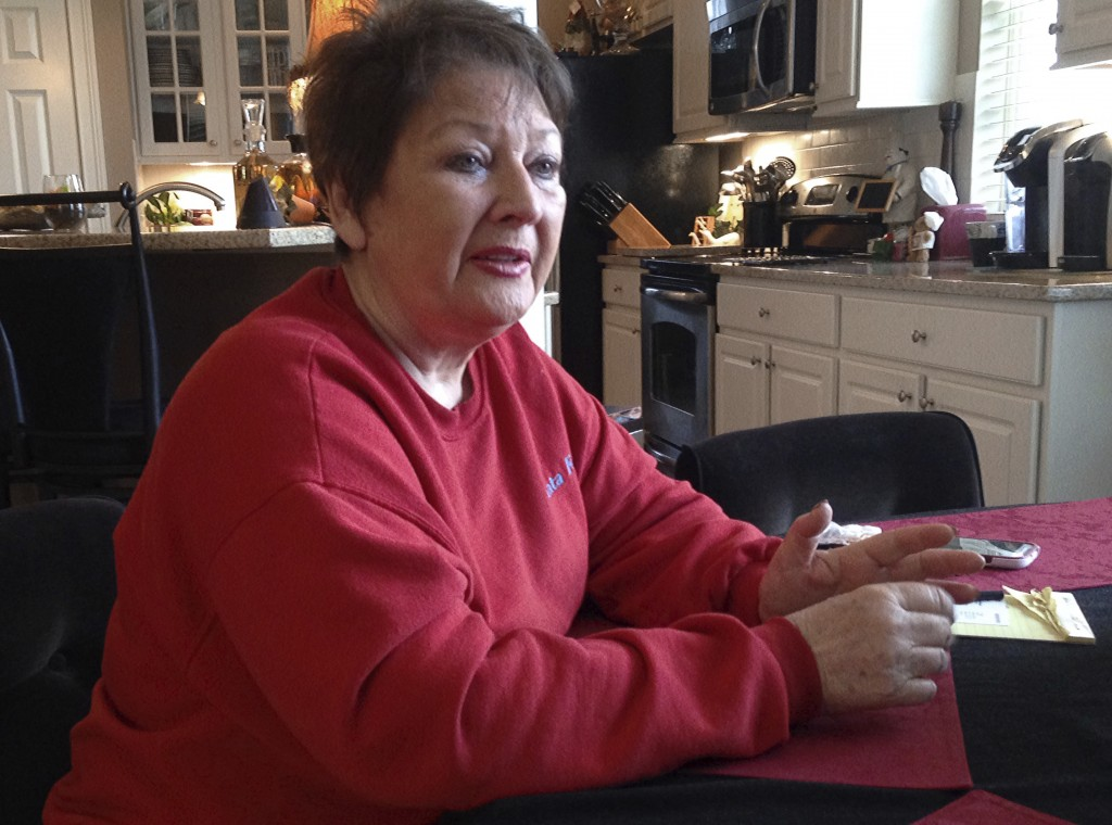 This Dec. 15, 2015 file photo shows Anita Barney talking about losing her fortune in a swindle perpetrated by former Ohio State quarterback Art Schlic...