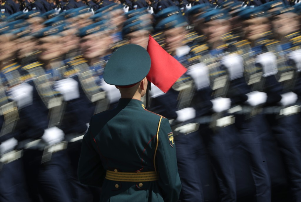 Russian soldiers march toward Red Square during the Victory Day military parade marking the 75th anniversary of the Nazi defeat in Moscow, Russia, Wed...
