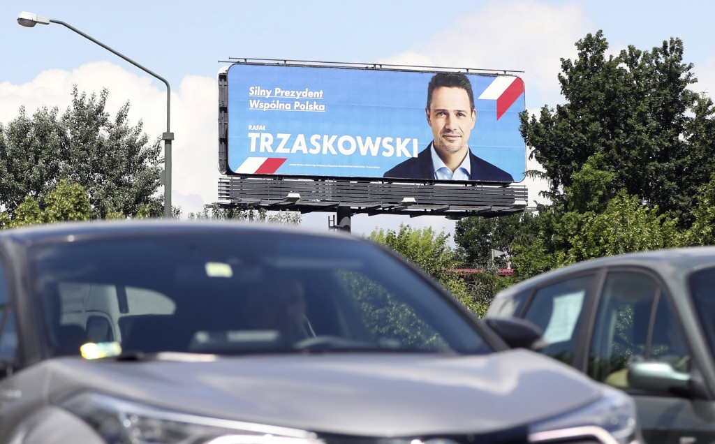 An electoral poster for Warsaw Mayor Rafal Trzaskowski is seen, in Warsaw, Poland, Tuesday, June 23, 2020. Trzaskowski polls as the main challenger to...