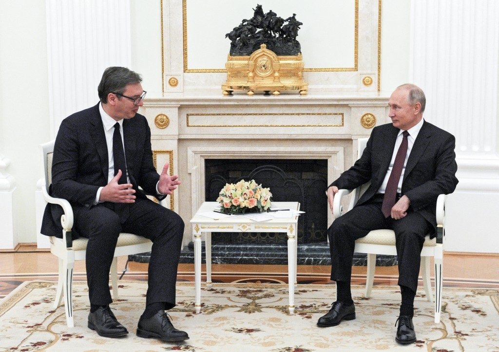 Russian President Vladimir Putin Putin, right, listens to and Serbian President Aleksandar Vucic during their meeting in the Kremlin in Moscow, Russia...