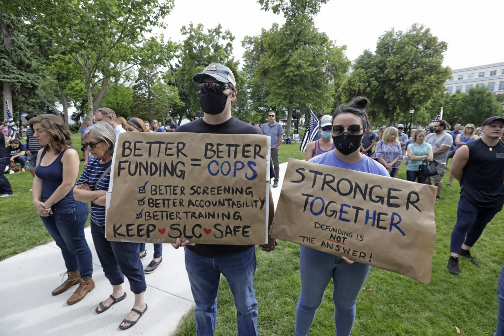 """People look on during the Utah Business Revival's """"Blue Rally"""" to support men and women of law enforcement Saturday, June 20, 2020, in Salt Lake City...."""