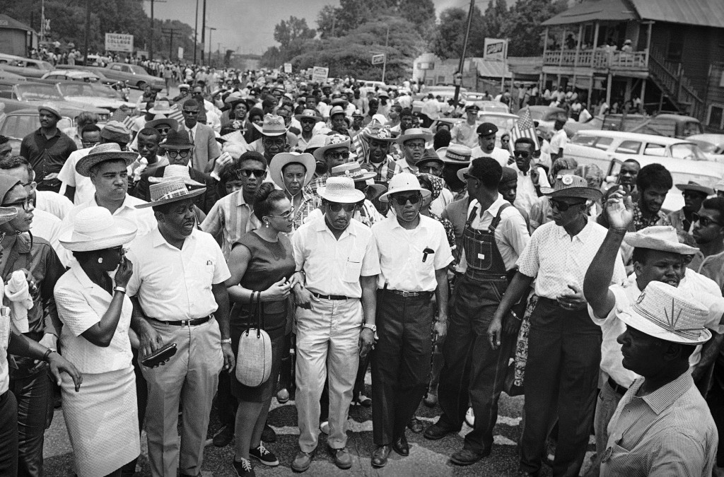 This Sunday, June 26, 1966 file photo shows thousands of civil rights marchers fall in behind their leaders on the last leg of the Mississippi March i...