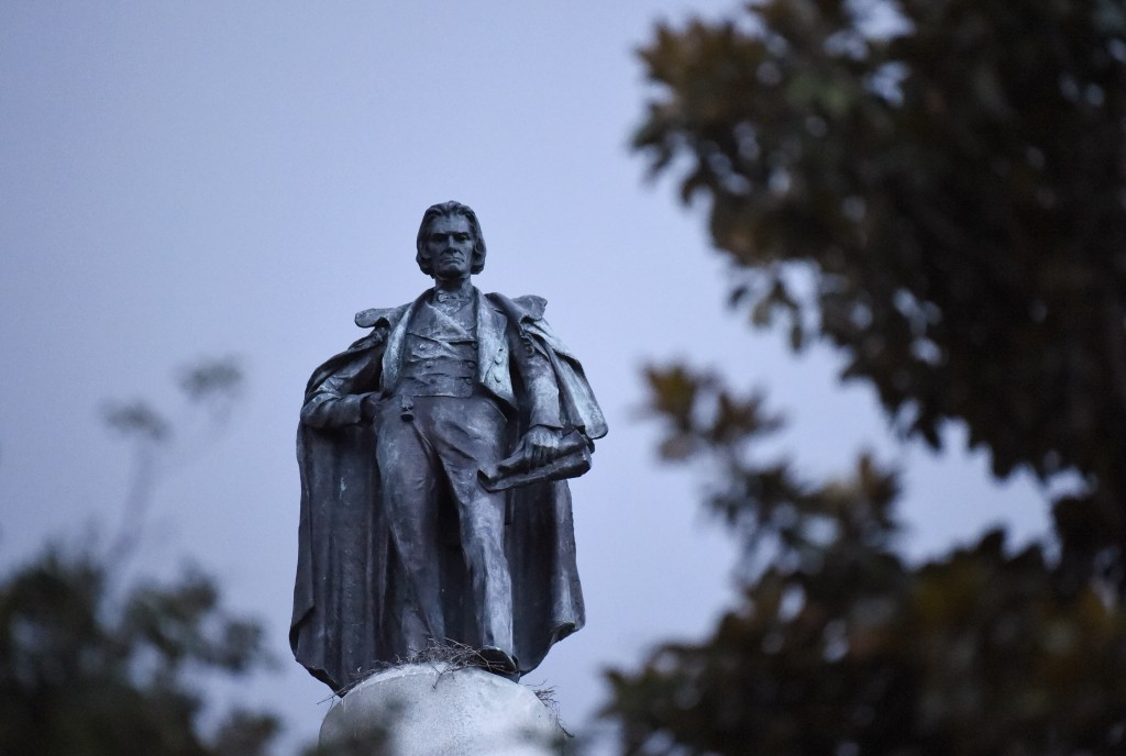 A 100-foot monument to former U.S. vice president and slavery advocate John C. Calhoun towers over a downtown square Tuesday, June 23, 2020, in Charle...