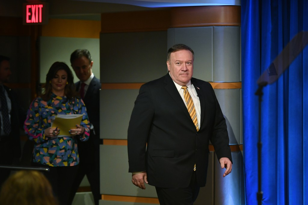 Secretary of State Mike Pompeo arrives to a press conference at the State Department, Wednesday, June 24, 2020 in Washington, followed by State Depart...